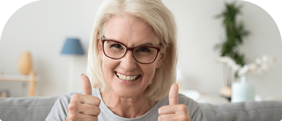 Woman Smiling and showing Thumbs Up sign