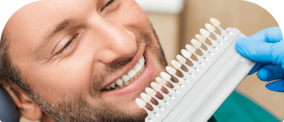 Dentist checking patient teeth colour
